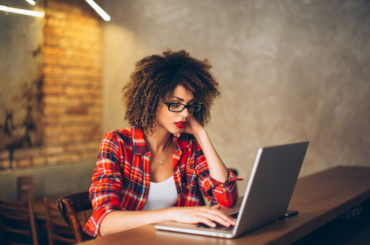 girl sitting at a laptop - how to get more page views on your blog