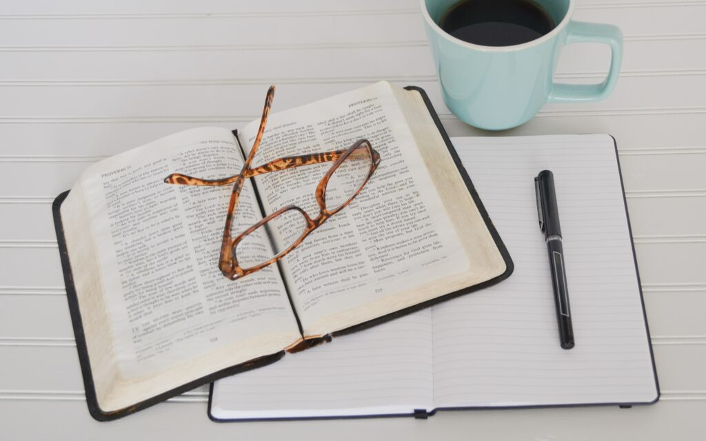 how to write a sermon with glasses on a Bible