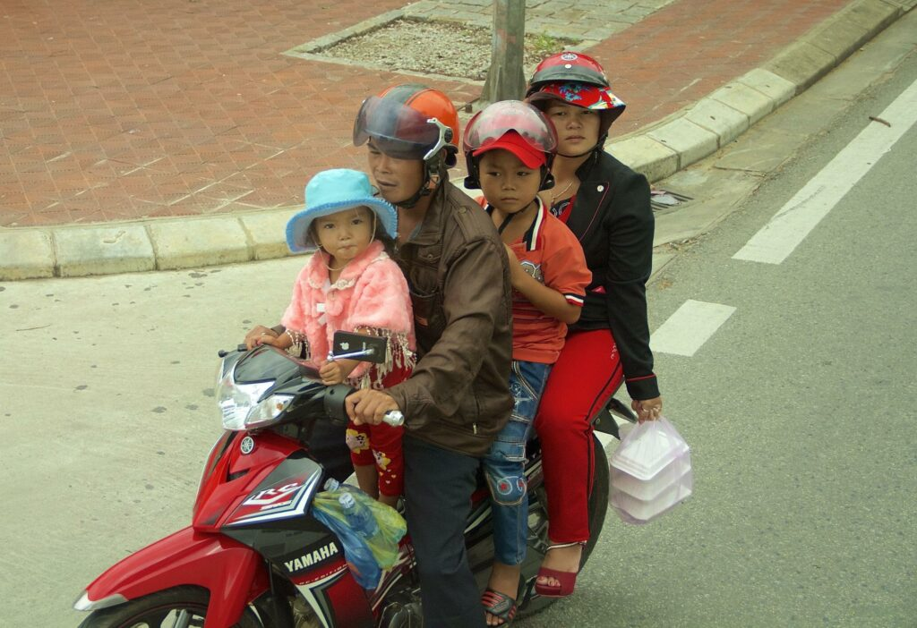 Family of four on one scooter - how to become a travel blogger