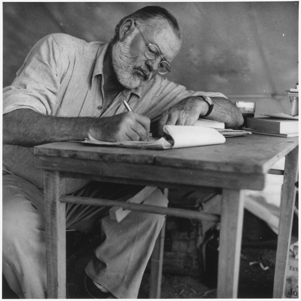 best Hemingway quotes, photograph of Hemingway writing