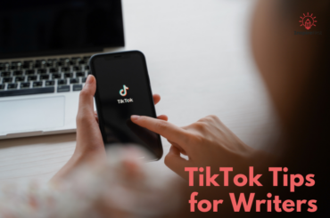 writers on Tiktok, photo of phone app with laptop