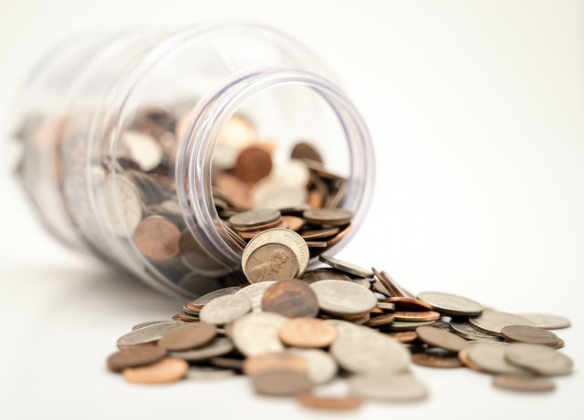 health insurance costs, coins in jar